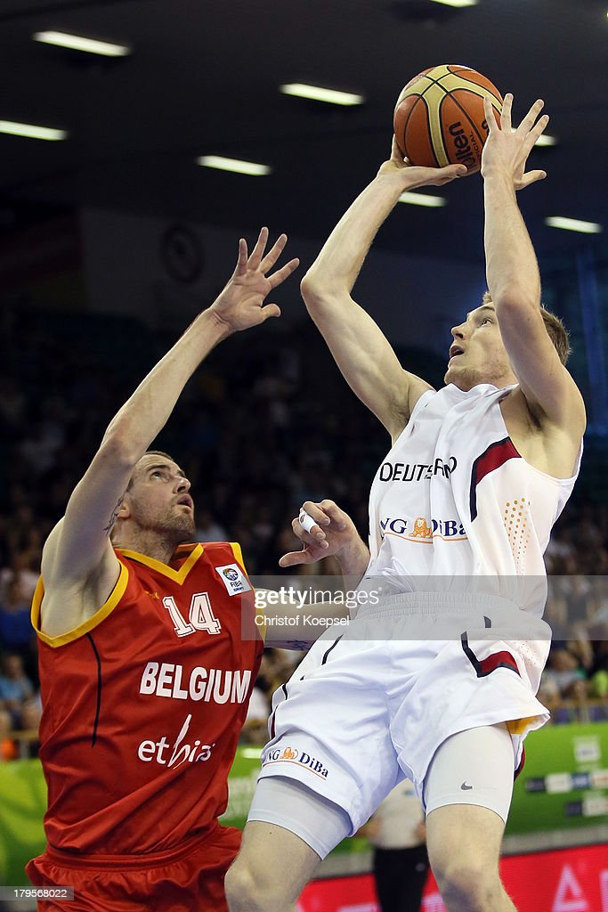 Sacha Massot of Belgium defends against Niels Giffey of Gemany during the FIBA European Championships 2013 first round group A match between Germany and Belgium at Tivoli Arena on September 5, 2013 in Ljubljana, Slovenia.