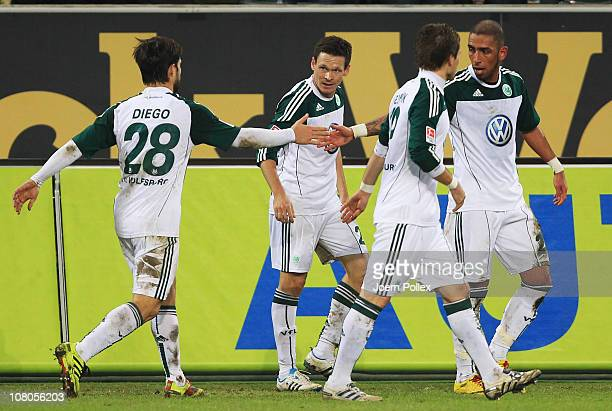 Sacha Riether of Wolfsburg celebrates with his team mates after scoring his team's first goal during the Bundesliga match between VfL Wolfsburg and...