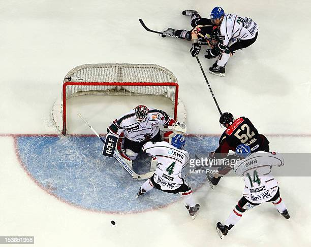 Sachar Blank of Hannover fails to score over Patrick Ehelechner , goaltender of Augsburg during the DEL match between Hannover Scorpions and...