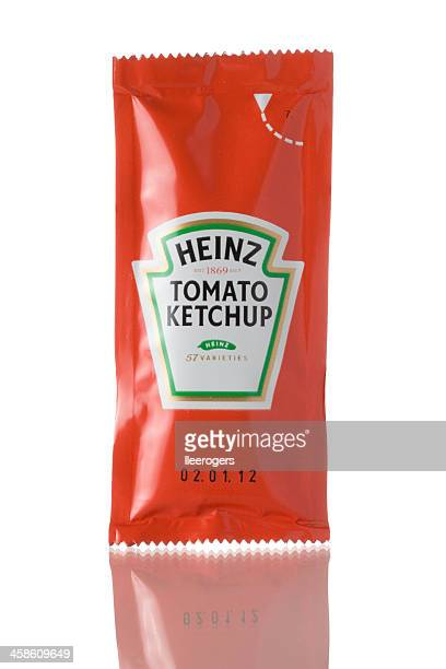 sachet of heinz tomato ketchup on a white background - ketchup stock photos and pictures