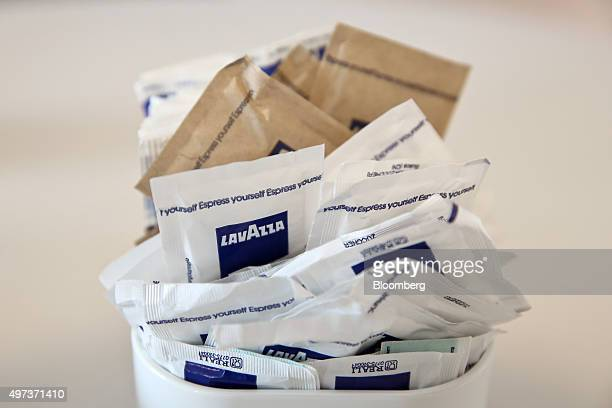 Sachets of sugar branded with Lavazza logo sit in a bowl at the Luigi Lavazza SpA coffee production and training facility in Turin Italy on Friday...