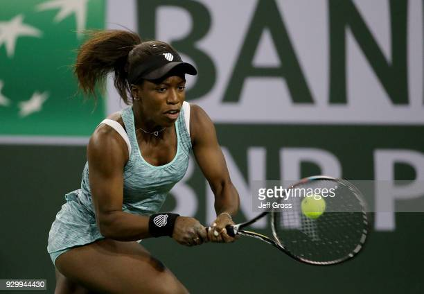 Sachia Vickery returns a backhand to Garbine Muguruza of Spain during the BNP Paribas Open at the Indian Wells Tennis Garden on March 9 2018 in...