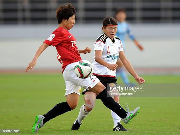 Sachie Takahashi of Yunogo Belle and Kiko Seike of Urawa Reds Ladies compete for the ball during the Nadeshiko League match between Urawa Red...