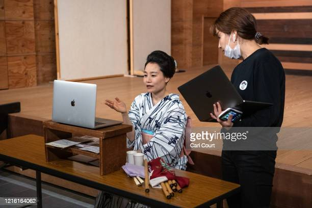 Sachika originally from Yokohama and a geisha for 20 years chats with Meet Geisha staff member Tamaki Nishimura as she prepares to entertain clients...