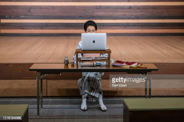 Sachika originally from Yokohama and a geisha for 20 years entertains clients online via Zoom on May 29 2020 in Hakone Japan A service known as Meet...