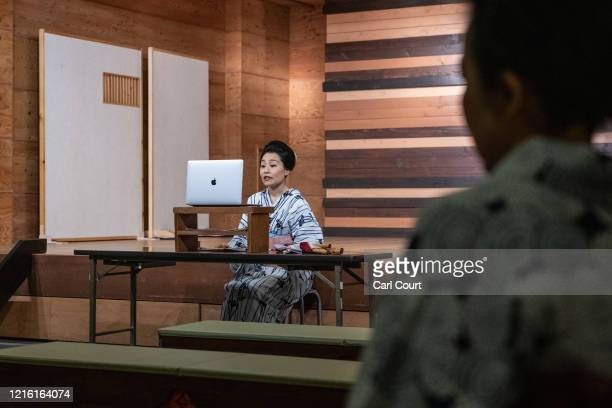 Sachika originally from Yokohama and a geisha for 20 years offers a toast as she entertains clients online via Zoom on May 29 2020 in Hakone Japan A...