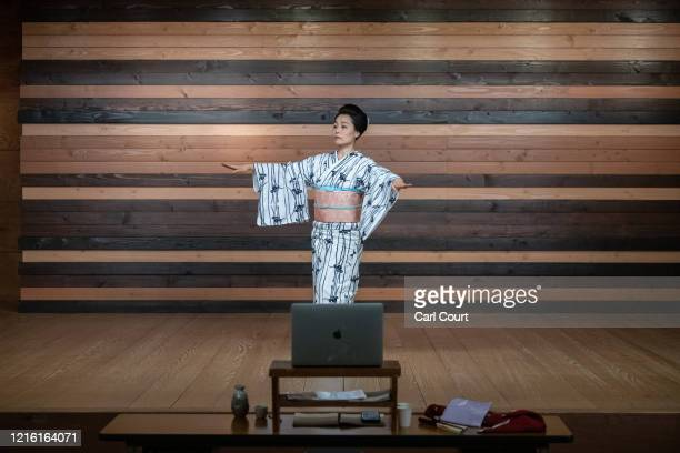 Sachika originally from Yokohama and a geisha for 20 years performs a dance as she entertains clients online via Zoom on May 29 2020 in Hakone Japan...