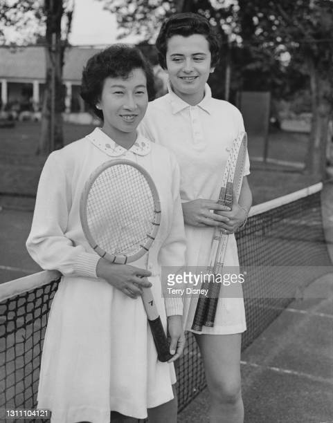 Sachiko Kamo of Japan with doubles partner Annie Soisbault of France during a practice session in preparation for the Wimbledon Championships on 14th...