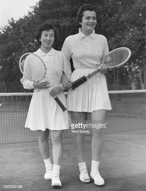 Sachiko Kamo of Japan with tennis doubles partner Annie Soisbault of France during a practice session in preparation for the Wimbledon Lawn Tennis...