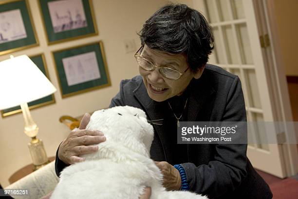 Sachiko McFadden speaks in Japanese with Paro the robot baby harp seal a Sept 25 2008 in McLean VA at Vinson Hall Retirement Community Home