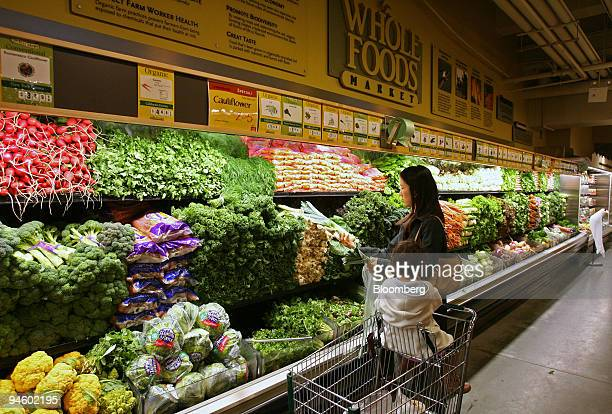 Sachiko Shioya and her daughter Momo shop for produce at a Whole Foods Market Thursday November 2 in New York Whole Foods Market Inc the largest US...