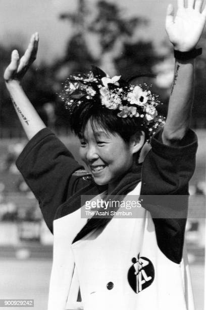 Sachiko Yamashita of Japan celebrates winning the 12th Nagoya International Women's Marathon at Mizuho Athletic Stadium on March 3 1991 in Nagoya...