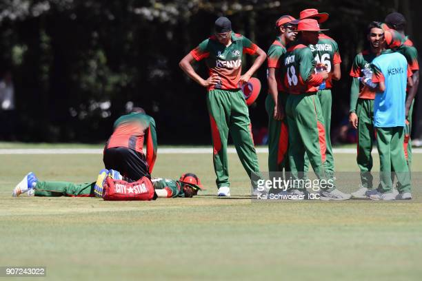 Sachin Bhudia of Kenya receives medical help during the ICC U19 Cricket World Cup match between the West Indies and Kenya at Lincoln Oval on January...