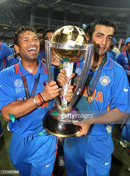 Sachin Tendulkar and Gautam Gambhir of India celebrate with the trophy after the 2011 ICC World Cup Final between India and Sri Lanka at Wankhede...