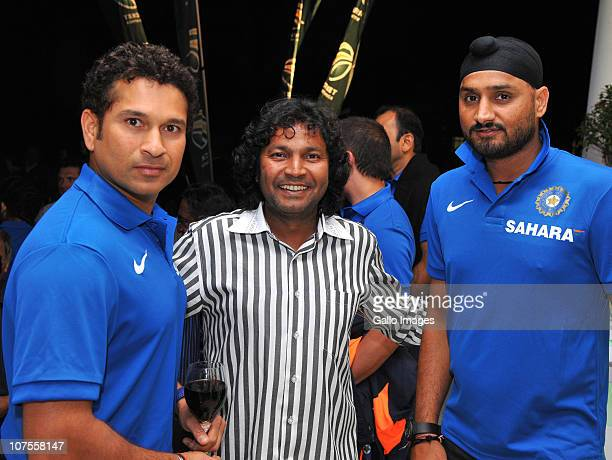 Sachin Tendulkar and Harbhajan Singh pose with a fan during the South African and Indian cricket team evening function at Summer Place on December 13...