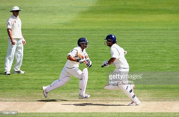 Sachin Tendulkar and Sourav Ganguly of India run between the wickets as Andrew Strauss of England looks on during day three of the Second Test match...