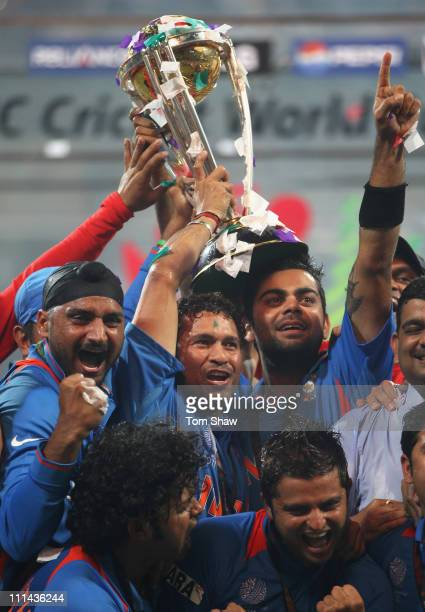 Sachin Tendulkar and Virat Kohli of India celebrate with the World Cup after beating Sri Lanka during the 2011 ICC World Cup Final between India and...