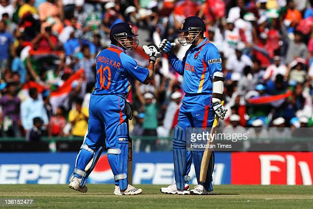 Sachin Tendulkar and Virendra Sehwag of Indiatalk in th middle during the 2011 ICC World Cup semifinal match between India and Pakistan at PCA...