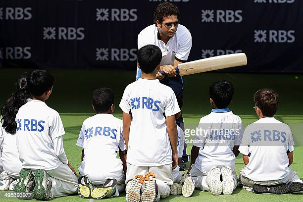 Sachin Tendulkar conducts a masterclass session with young cricketers at the Singapore Cricket Club on June 3 2014 in Singapore