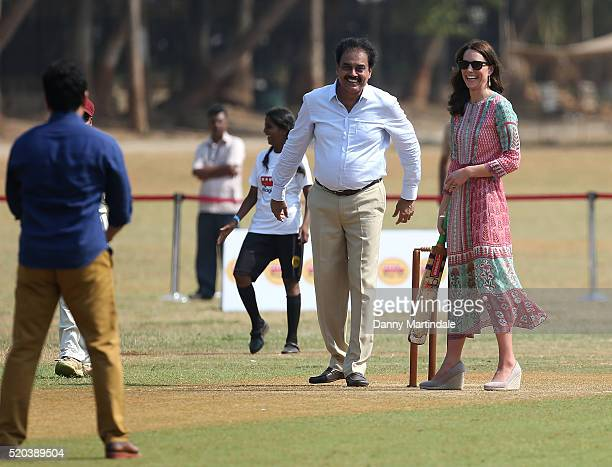 Sachin Tendulkar gives advise to Catherine Duchess of Cambridge as she plays cricket during a visit to meet children from Magic Bus Childline and...
