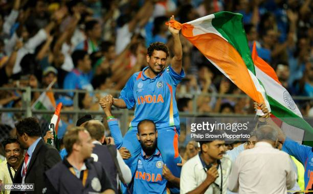 Sachin Tendulkar is carried on a lap of honour by his teammate Yusuf Pathan following India's victory in the ICC Cricket World Cup Final after...