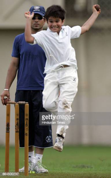 Sachin Tendulkar is pleased as his son Arjun celebrates with his friends in a friendly cricket match on the eve of Arjun's birthday at MIG club Bandra