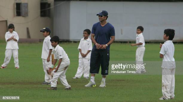 Sachin Tendulkar is pleased as his son Arjun celebrates with his friends in a friendly cricket match on the eve of his birthday at MIG club Bandra on...