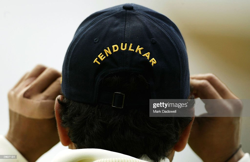 Sachin Tendulkar of India adjusts his cap during the second day of the 2nd Test between Australia and India at the Adelaide Oval on December 13, 2003 in Adelaide, Australia.