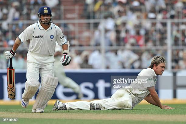 Sachin Tendulkar of India and Paul Harris of South Africa during day two of the Second Test match between India and South Africa at Eden Gardens on...
