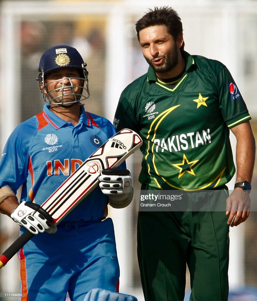 Sachin Tendulkar of India and Shahid Afridi of Pakistan exchange words after Tendulkar was dropped by Younis Khan off Afridi`s bowling during the...