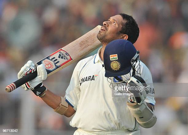 Sachin Tendulkar of India celebrates his 47th test hundred during day two of the Second Test match between India and South Africa at Eden Gardens on...