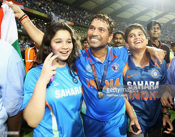 Sachin Tendulkar of India celebrates his teams win with his daughter Sara and son Arjun during the 2011 ICC World Cup Final between India and Sri...