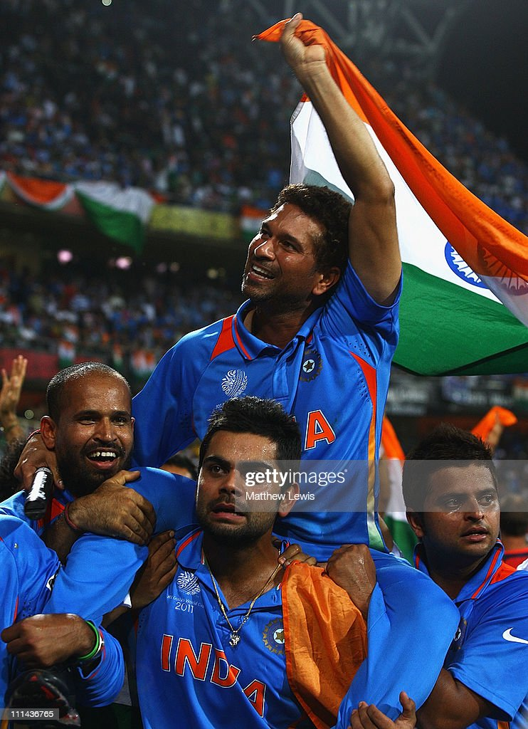 Sachin Tendulkar of India celebrates his teams win Yusuf Pathan and Virat Kohli during the 2011 ICC World Cup Final between India and Sri Lanka at the Wankhede Stadium on April 2, 2011 in Mumbai, India.