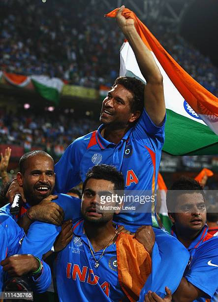 Sachin Tendulkar of India celebrates his teams win Yusuf Pathan and Virat Kohli during the 2011 ICC World Cup Final between India and Sri Lanka at...