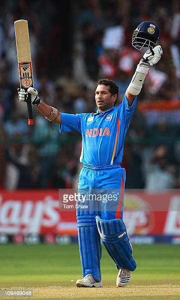Sachin Tendulkar of India celebrates reaching his century during the 2011 ICC World Cup Group B match between India and England at M Chinnaswamy...