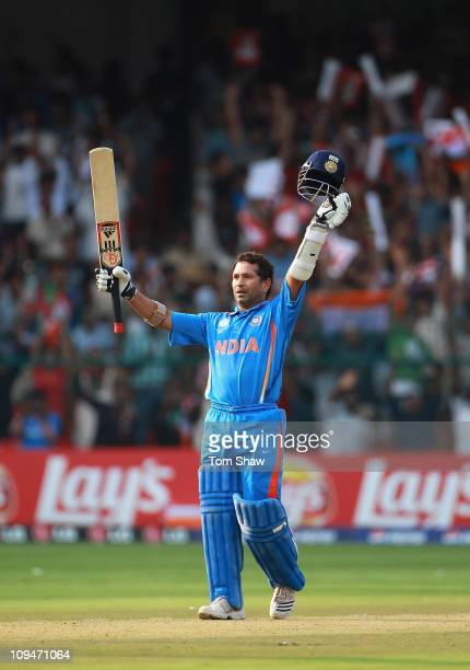 Sachin Tendulkar of India celebrates reaching his century during the 2011 ICC World Cup Group B match between India and England at M. Chinnaswamy...