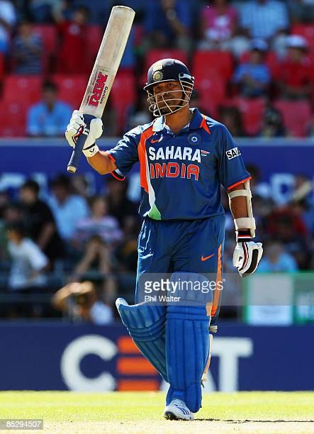 Sachin Tendulkar of India celebrates reaching his half century during the third One Day International match between the New Zealand Blacks Caps and...