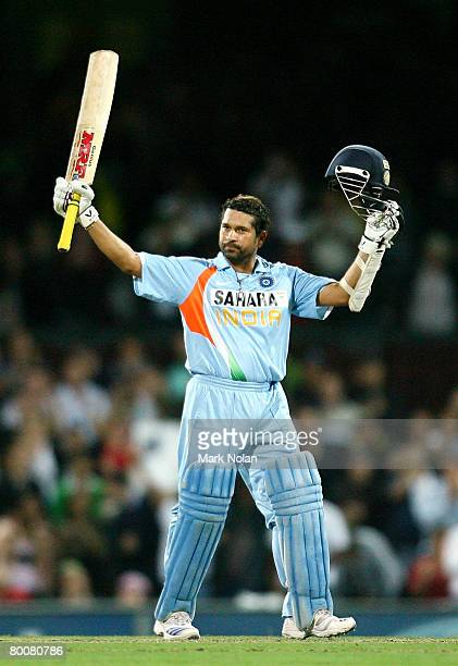 Sachin Tendulkar of India celebrates scoring a century during the Commonwealth Bank One Day International Series first final match between Australia...