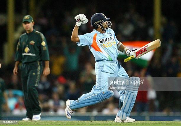 Sachin Tendulkar of India celebrates scoring a century during the Commonwealth Bank One Day International Series first final match between Australia...
