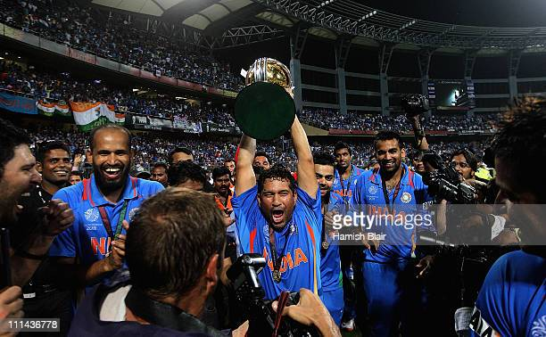 Sachin Tendulkar of India celebrates with the trophy after the 2011 ICC World Cup Final between India and Sri Lanka at Wankhede Stadium on April 2...