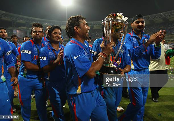 Sachin Tendulkar of India celebrates with the World Cup after beating Sri Lanka during the 2011 ICC World Cup Final between India and Sri Lanka at...