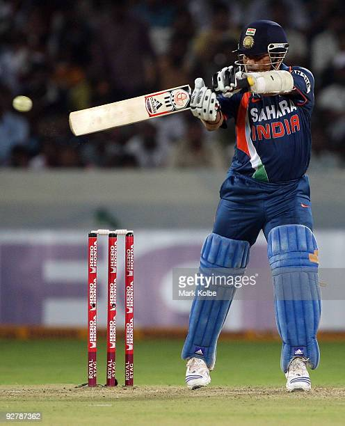 Sachin Tendulkar of India cuts the ball behind square during the fifth One Day International match between India and Australia at Rajiv Gandhi...