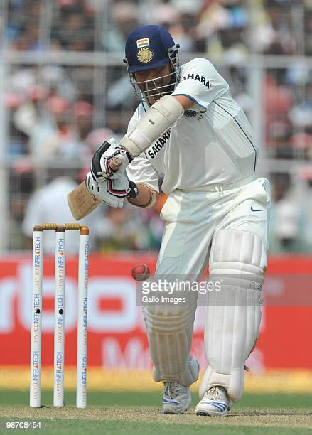 Sachin Tendulkar of India drives through the covers during day two of the Second Test match between India and South Africa at Eden Gardens on...