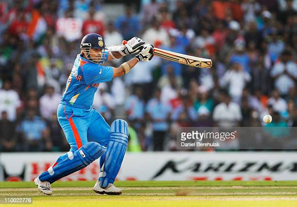 Sachin Tendulkar of India drives to bring up his century during the Group B ICC World Cup Cricket match between India and South Africa at Vidarbha...