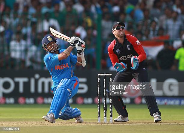Sachin Tendulkar of India hits a six during the 2011 ICC World Cup Group B match between India and England at M Chinnaswamy Stadium on February 27...