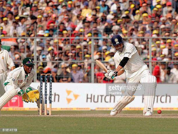 Sachin Tendulkar of India hits out during day 5 of the second test between India and South Africa at Eden Gardens on December 2 2004 in Calcutta India