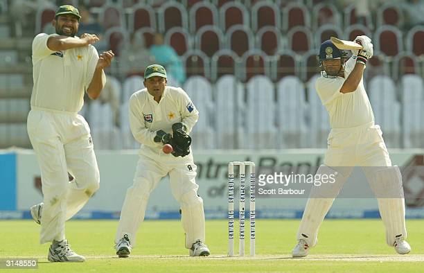 Sachin Tendulkar of India hits out during day one of the 1st Test Match between Pakistan and India at Multan Stadium on March 28, 2004 in Multan,...