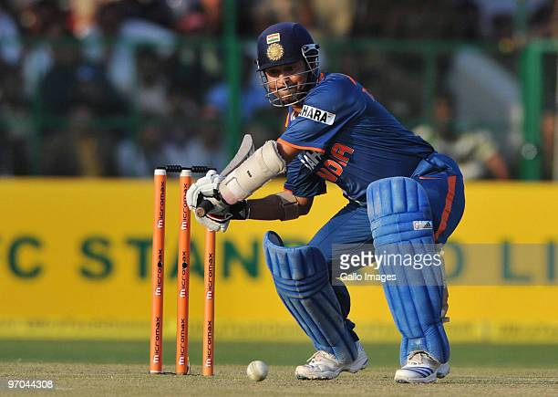 Sachin Tendulkar of India hits out on his way to a record double century during the 2nd ODI between India and South Africa at Captain Roop Singh...