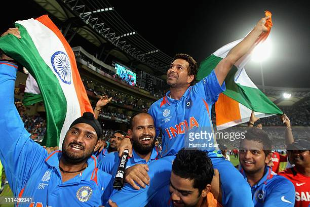 Sachin Tendulkar of India is chaired around the field by team mates as they celebrate victory after the 2011 ICC World Cup Final between India and...