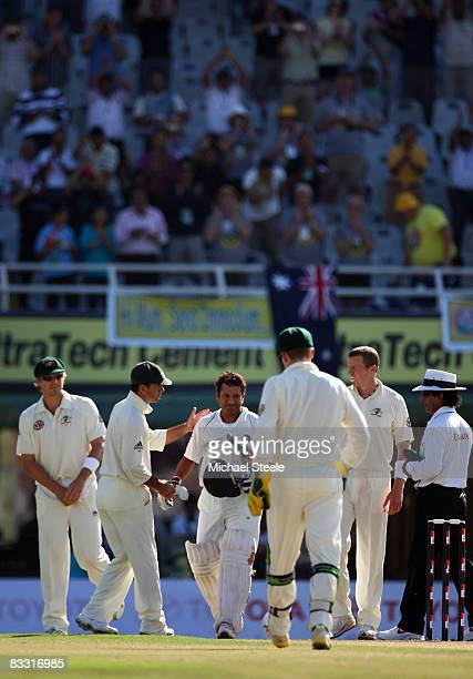 Sachin Tendulkar of India is congratulated by Ricky Ponting of Australia after becoming the highest run scorer in Test cricket during day one of the...